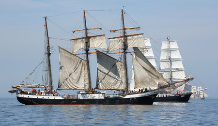 yachtsman: PORT WARNEMUENDE, GERMANY - August 6, 2015 Old sailing ships Mercedes Netherland and Fridtjof Nansen Germany sailing near Rostock-Warnemnde on August 6, 2015 in the scope of the 25th Hanse Sail Rostock - Mecklenburg-Vorpommern, Germany