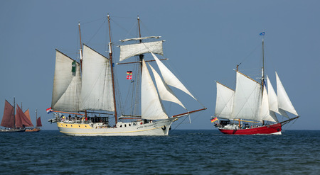 yachtsman: PORT WARNEMUENDE, GERMANY - August 6, 2015 Old sailing ships Mare Frisum Netherland and Germany Ryvar sailing near Rostock-Warnemnde on August 6, 2015 in the scope of the 25th Hanse Sail Rostock - Mecklenburg-Vorpommern, Germany