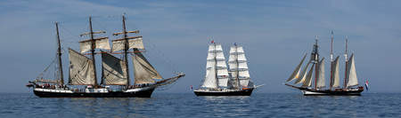 yachtsman: PORT WARNEMUENDE, GERMANY - August 6, 2015 Old sailing ships Oosterschelde, Mercedes Netherland and Fridtjof Nansen Germany are sailing near Rostock-Warnemnde on August 6, 2015 in the scope of the 25th Hanse Sail Rostock - Mecklenburg-Vorpommern, Germany Editorial