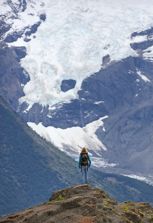 Young women in front of Glaciar Torres - Torres del Paine NP, Patagonia, Chile Imagens