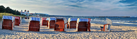 Canopied beach chairs at the beach near Binz at the Baltic Coast - Iceland Rugia, Germany Фото со стока