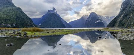 Reflections at Milford Sound - Fiordland, New Zealand Фото со стока