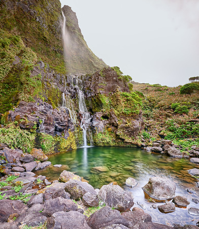 Panoramic view of pond and waterfall Poco do Bacalhau at the Azores island of Flores