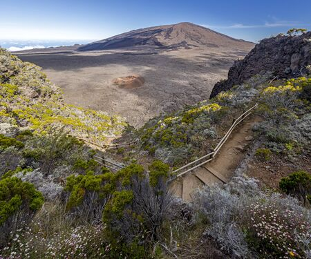 Hiking trail into the Caldeira of volcano Piton de la Fournaise at island La Reunion
