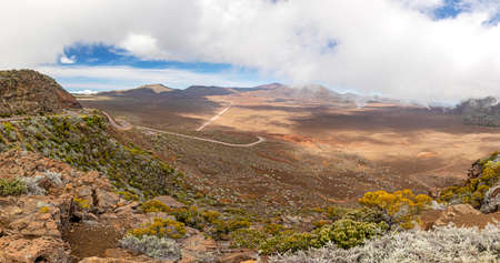 Panoramic view of the Plaine des Sable with way to volcano Piton de la Fournaise at island La Reunion