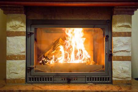 Burning fireplace. Fireplace as an interior item for a designer