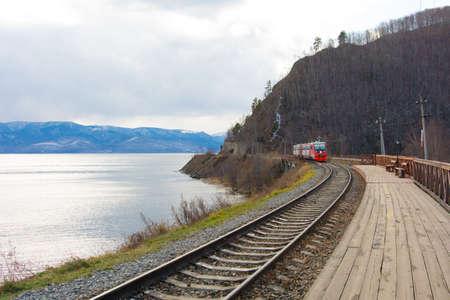 Circum Baikal railway and train. Circum-Baikal railway and train arriving at Slyudyanka station.
