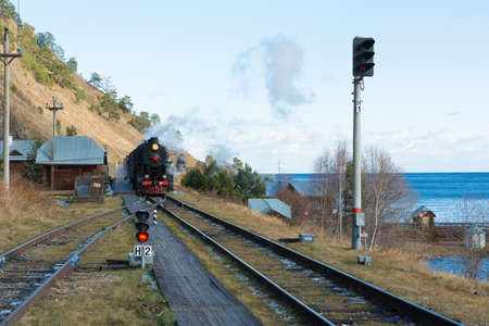 Circum Baikal railway and train. Circum-Baikal Railway and a steam locomotive arriving at the station.
