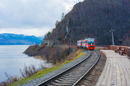 Circum Baikal railway and train. Circum-Baikal railway and train arriving at Slyudyanka station.