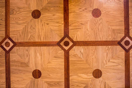 The texture of the parquet is light brown.