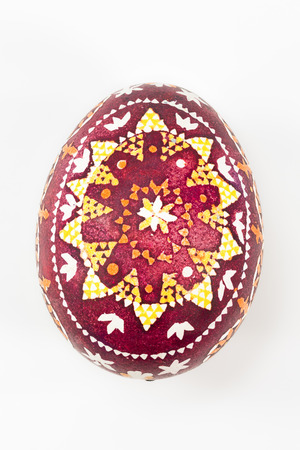customs and celebrations: isolated Sorbian painted easter egg on white background