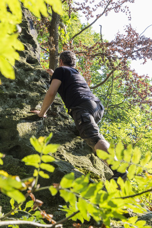 saxon: freeclimber in Saxon Switzerland (Lilienstein mountain), Koenigstein, Germany Stock Photo