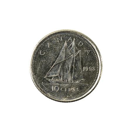 10 캐나다 달러 동전 (1998)도 생 흰색 배경에 고립