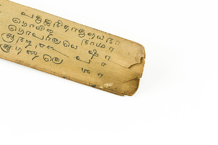 sanskrit: detail of a preserved palm leaf (borassus flabellifer) manuscripts showing writings about ayurvedic medicines in old malayalam script from Kerala, India