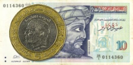 dinar: 5 dinar coin against 10 tunisian dinar bank note obverse Stock Photo