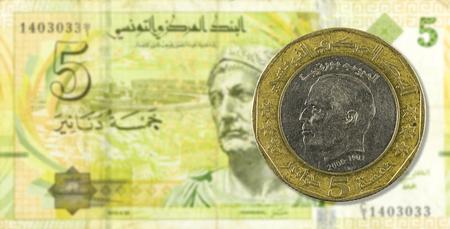 dinar: 5 dinar coin against 5 tunisian dinar bank note obverse Stock Photo