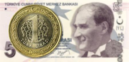 turkish lira: 1 lira coin against 5 turkish lira bank note obverse