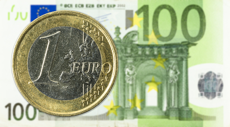 1 euro coins against 100 euro bank note obverse