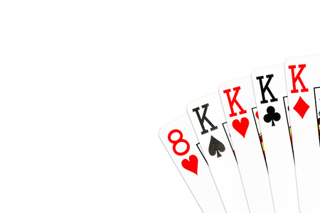 poker hand four of a kind in kings with 8 of hearts as kicker card