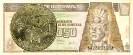 1 quetzal coin against 0,5 guatemalan quetzal bank note obverse