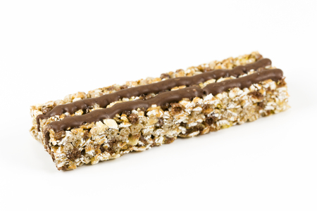 granola bar with chocolate strips on white background