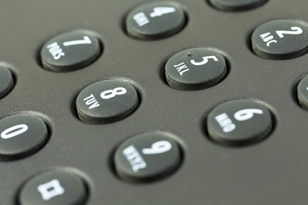 keypad with letter mapping of a black telephone