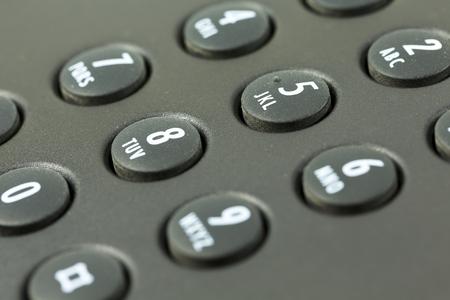 Teclado con mapeo de letras de un teléfono negro Foto de archivo - 76537077