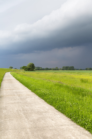 upcoming thunderstorm on Elbe cycle path in Lower Saxony Stock Photo