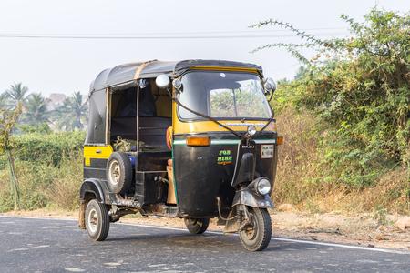 auto rickshaw, tuk-tuk on the road, Hampi, Karnataka, India Stock Photo