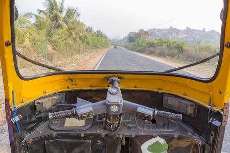 cockpit of an auto rickshaw, tuk-tuk on the road, Hampi, Karnataka, India