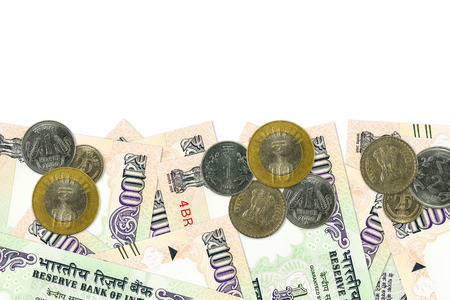 some 100 indian rupee bank notes and coins