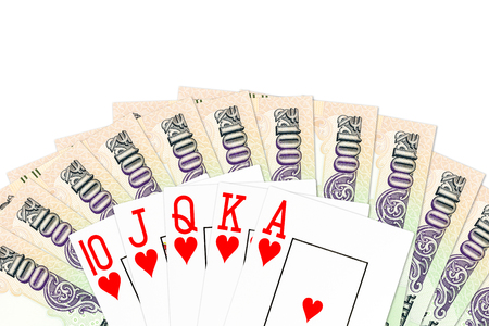 poker hand royal flush in hearts against indian rupee bank notes isolated on white background