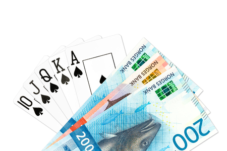 poker hand royal flush in spades and some norwegian krone bank notes isolated on white background