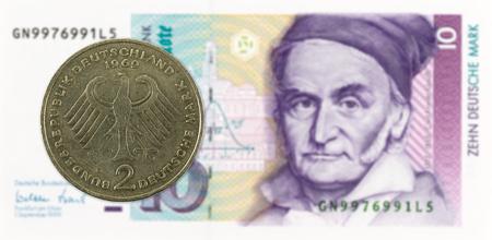 2 german mark coin against 10 german mark bank note Standard-Bild - 102429544