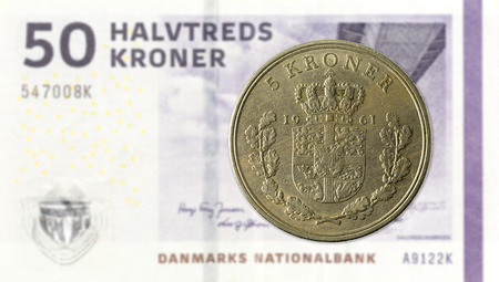 5 danish krone coin against 50 danish krone note
