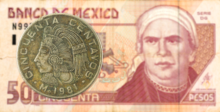 5 mexican peso coin against 50 mexican peso bank note