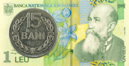 15 romanian bani coin against 1 romanian leu bank note