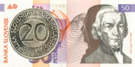 20 slovenian tolar coin against 50 slovenian tolar banknote obverse