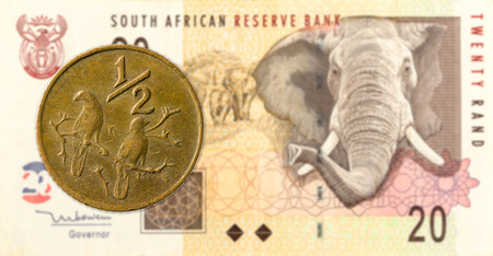 0,5 south african aforika coin against 20 south african rand banknote