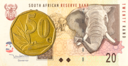 50 south african aforika coin against 20 south african rand banknote