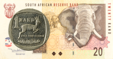 1 south african rand coin against 20 south african rand banknote