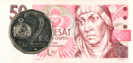 2 czech koruna coin against 50 czech koruna banknote