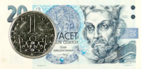 1 czech koruna coin against 20 czech koruna banknote