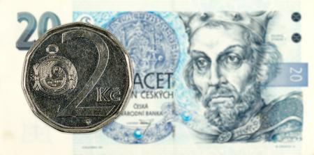2 czech koruna coin against 20 czech koruna banknote Reklamní fotografie