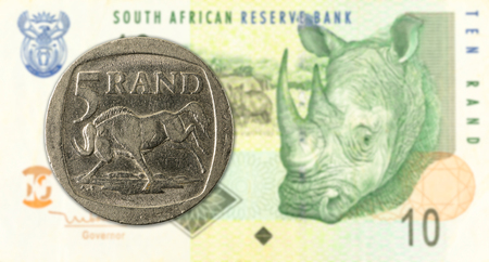 5 rand coin against 10 south african rand bank note obverse Stock fotó