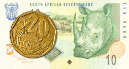 20 south african aforika coin against 10 south african rand banknote