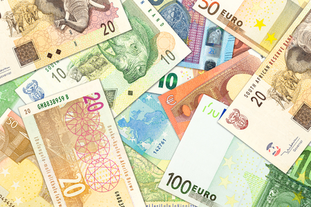 some south african rand banknotes and euro banknotes indicating trade relations