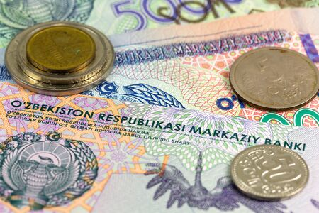 some Uzbek coins and banknotes indicating growing economy of Uzbekistan