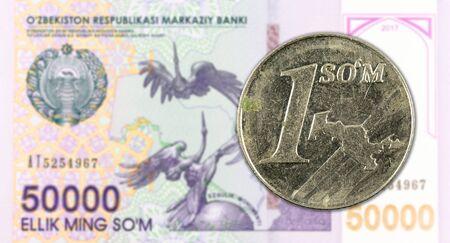 1 Uzbek Som coin against 50000 Uzbek Som banknote