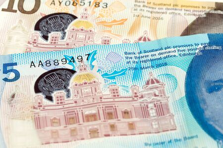 detail of 5 and 10 Pounds Sterling notes issued by Bank of Scotland Imagens